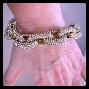Gold Pave twist link bracelet with crystals.